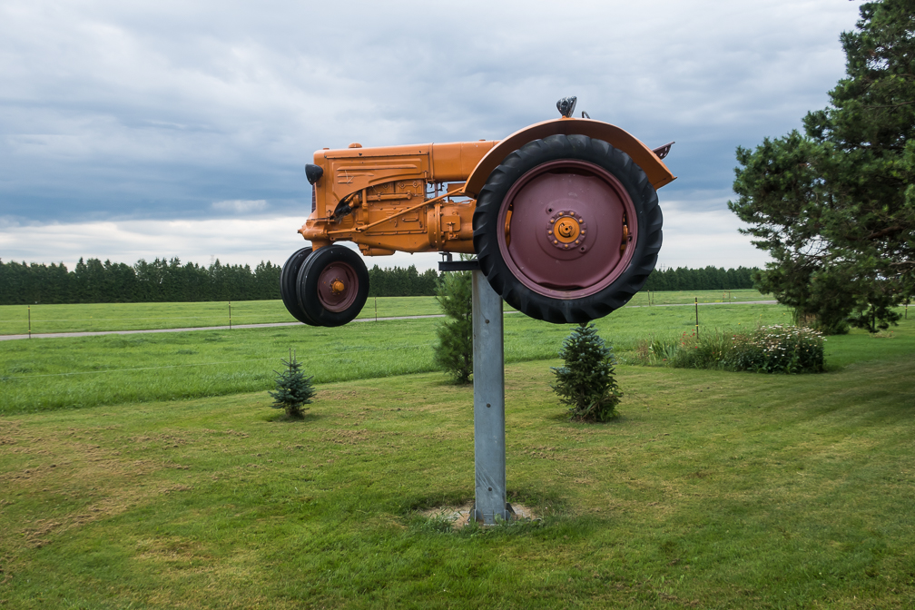 A tractor raided off the ground on a metal pole