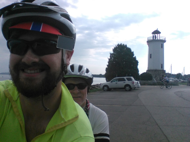 James and Chris are seen in the foreground and the lighthouse in the background.