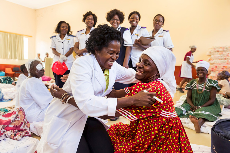 Dr. Helena Ndume embraces a patient after the bandages come off - Oshakati, Namibia