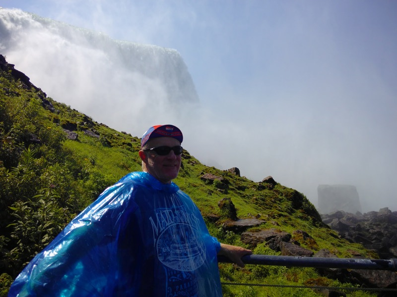 "Chris wears his ""Maid of the Mist"" poncho and stands in front of the US falls"