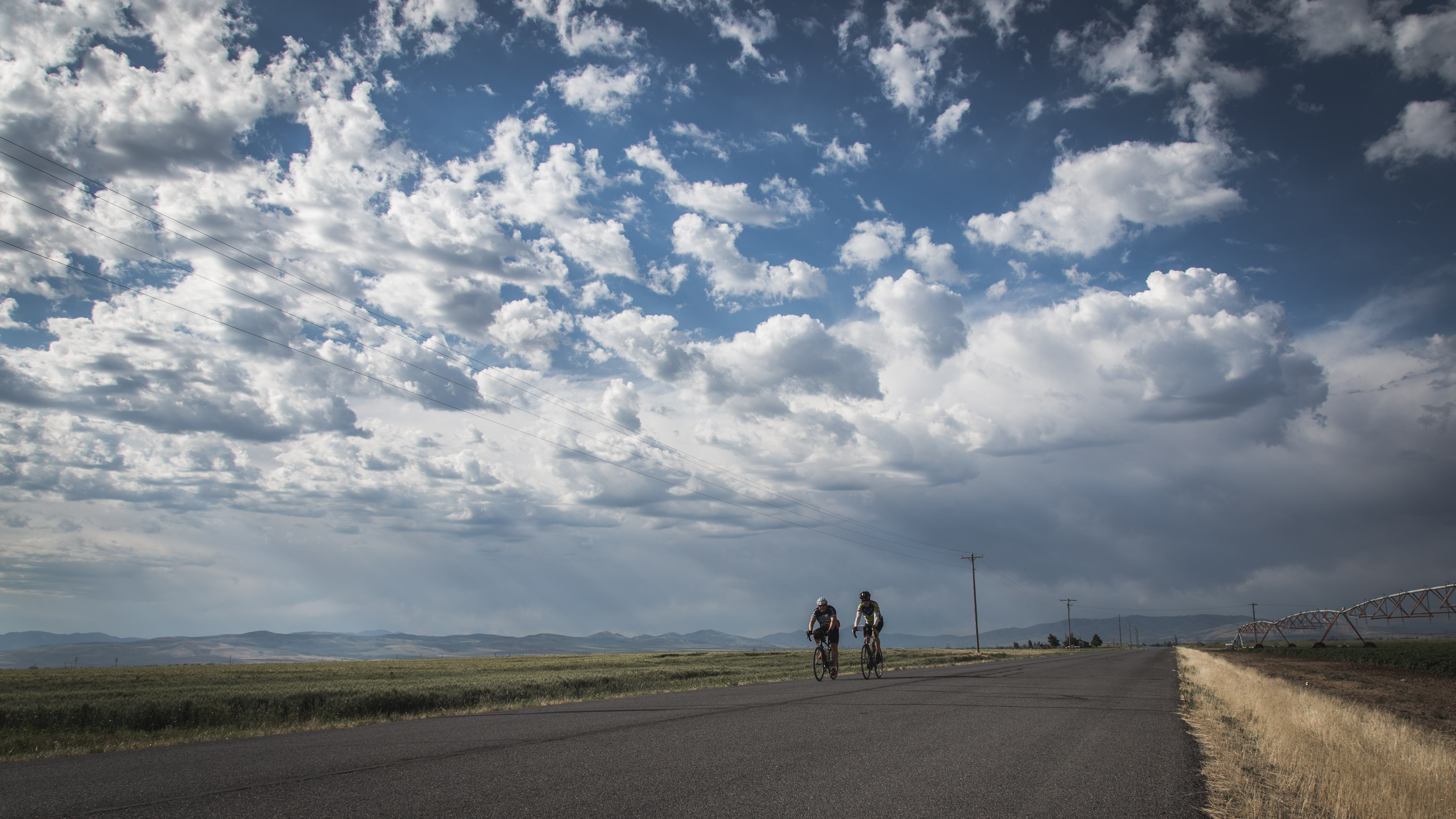 Cyclists and clouds