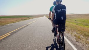 Photo of Chris and Alis backsides on the tandem