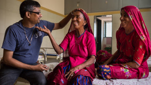 Dr. Shah screens woman in Siliguri, India Clinic