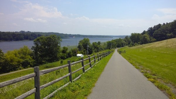 The bike path with lake and trees in the background